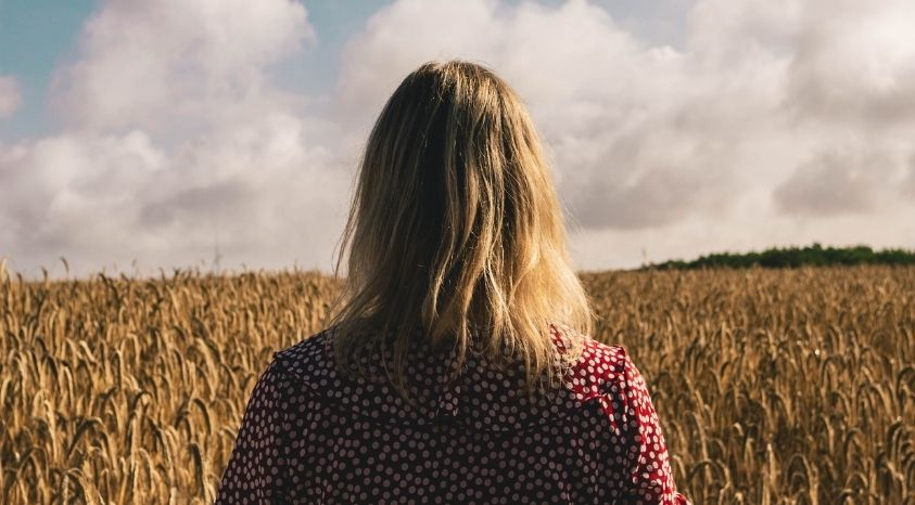 girl standing in a field