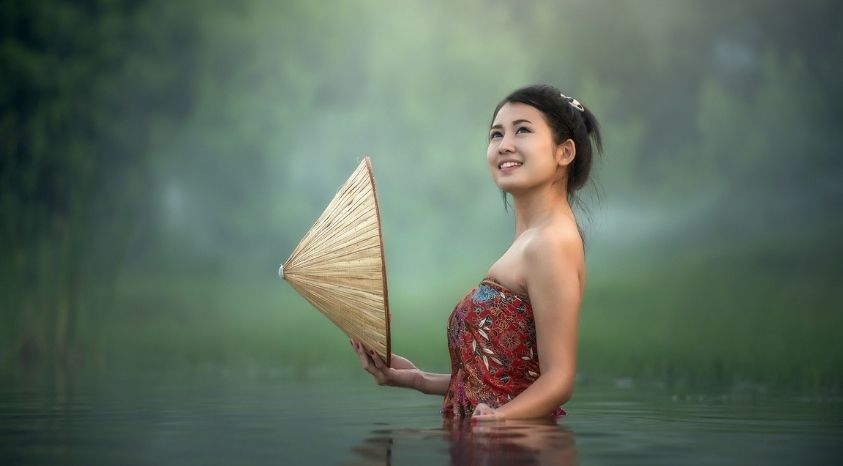 girl in a lake smiling